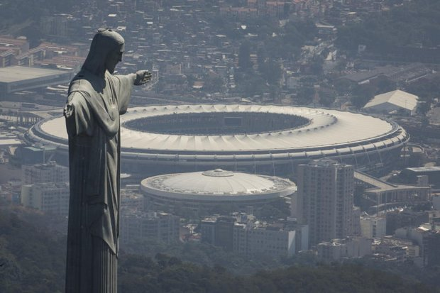 The Christ the Redeemer statue stands above Maracana Olympic stadium in Rio de Janeiro on Monday. There is wide concern over air quality. (AP photo)