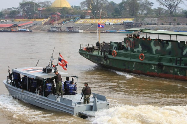 Boats from Thailand and Laos patrol the Mekong River river together as part of the Safe Mekong Joint Operation.