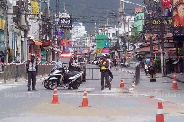 Police block a road near Patong Beach in Phuket following a bombing incident on Friday. (Photo by Achadtaya Chuenniran)