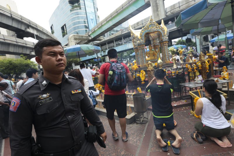 Nose for trouble: Security officials patrol Ratchaprasong intersection, a prime tourist spot in Bangkok.