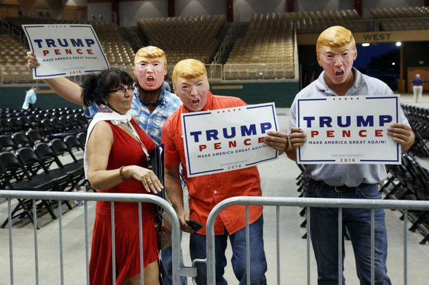 Supporters of Republican presidential candidate Donald Trump pose for a photograph after a campaign rally last Thursday in Florida. (AP photo)
