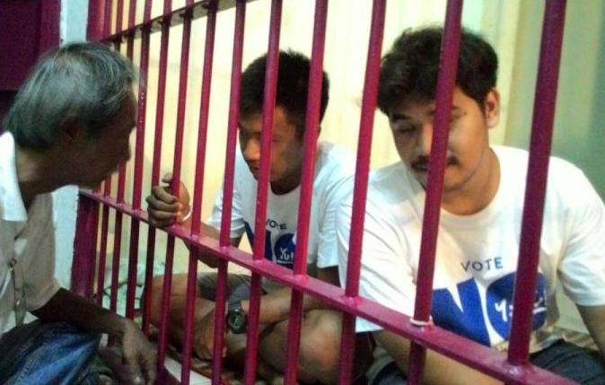 Jatupat Boonpattararaksa (centre), a student at Khon Kaen University in the northeast, was detained for handing out