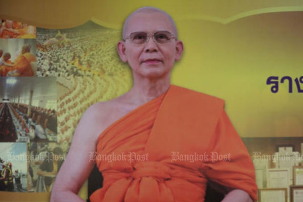 A large poster of Phra Dhammajayo, the abbot of Wat Phra Dhammakaya, in front of a hall inside the temple in Pathum Thani.  (File photo by Pattanapong Hirunard)