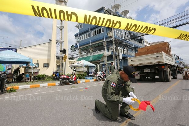 A security officer inspects the scene of an explosion in Hua Hin, Prachuap Khiri Khan province, after multiple bombs went off on Friday. (Photo by Pattanapong Hirunard)