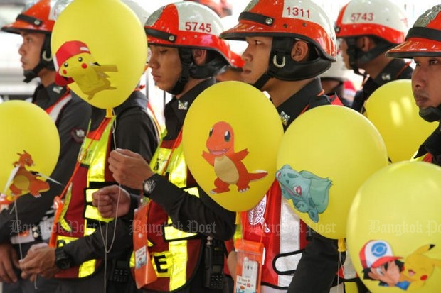 Police were given balloons and orders to find all 'Pokemon Go' players on major roads, allegedly because of all the accidents being caused. (Photo by Wichan Charoenkiatpakul)