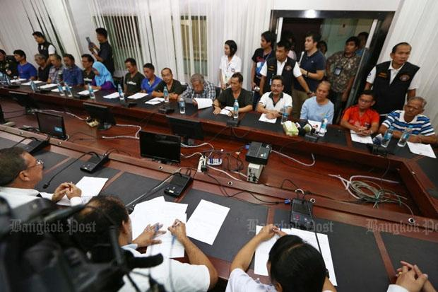 The 15 alleged members of an anti-government group are brought to a media briefing at the Crime Suppression Division in Bangkok on Friday. (Photo by Seksan Rojjanametakun)