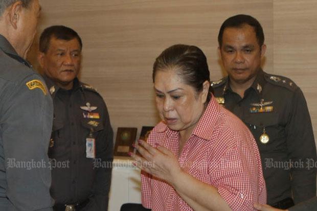 Fraud suspect Kamonthat Thanathornkhositjira, 62, sister of lese majeste suspect Monta