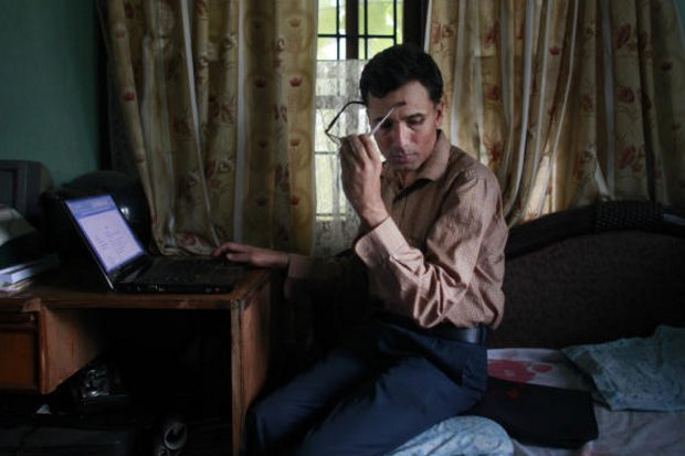 Suman Adhikari will never receive justice for the murder by Maoists of his father, Muktinath, who was dragged out of a classroom he was teaching, tied to a tree and riddled with bullets by the Maoists who now control the country and seek to forget the past. (AP Photo)