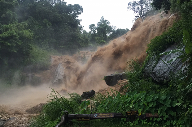 Muddy runoff from heavy rain tumbles down Mae Klang waterfall in Doi Inthanon, Chiang Mai province. The falls have been closed to visitors until further notice. (Photo by Cheewin Sattha)