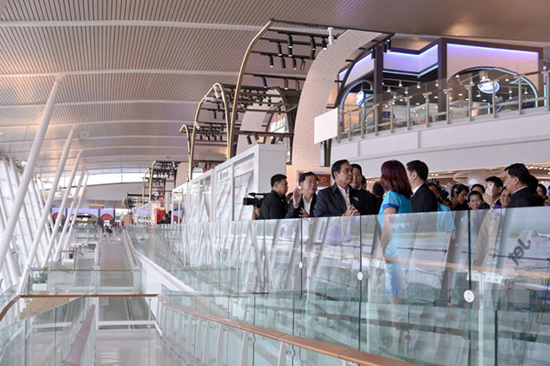 Prime Minister Prayut Chan-o-cha is shown around the new passenger terminal at Phuket airport on Friday. (Government House photo)