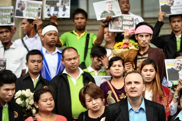 Andy  Hall (lower right) and supporters: Guilty of defamation and guilty of using a computer while defaming. (AFP photo)