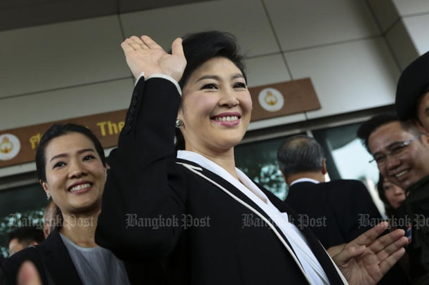 Former prime minister Yingluck Shinawatra greets supporters prior to an appearance last month at the Supreme Court in Bangkok, where her trial for dereliction of duty in connection with the rice-pledging programme is taking place. Defence testimony is scheduled to continue until February next year. (Photo by Patipat Janthong)