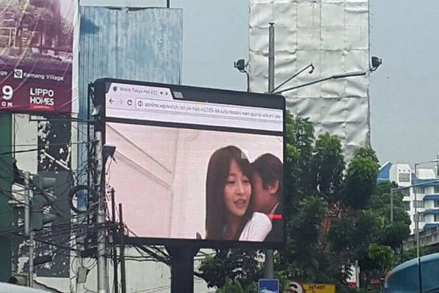 A photo taken by a Twitter user of the billboard in Jakarta when it showed a Japanese porn movie playing in an internet browser instead of ads on Friday. (Twitter photo/@Prunamasari)