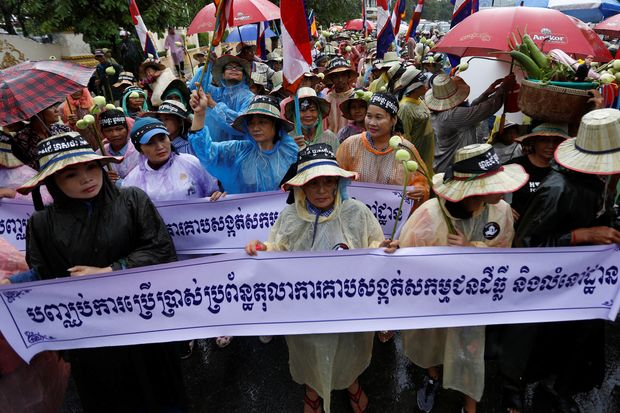 People take part in a rally marking World Habitat Day, to appeal to the Cambodian government to stop evicting people from their homes, according to rally organisers, in central Phnom Penh on Monday. (Reuters photo)