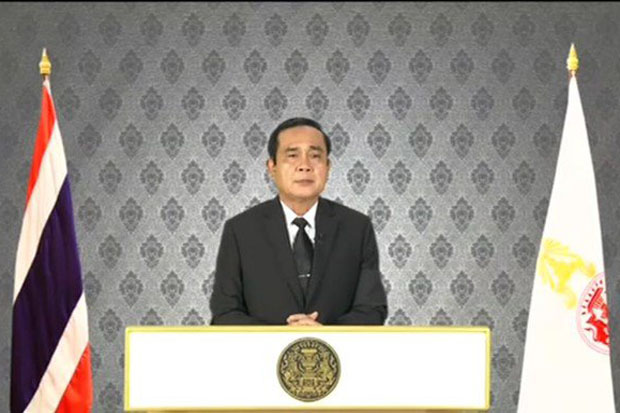 Prime Minister Prayut Chan-o-cha addresses the nation after the announcement of His Majesty King Bhumibol's demise.