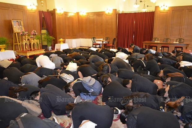 Mourners prostrate themselves before a portrait of His Majesty King Bhumibol inside the Sala Sahathai Samakhom Pavilion at the Grand palace on Saturday. (Photo courtesy of the Royal Household Bureau)