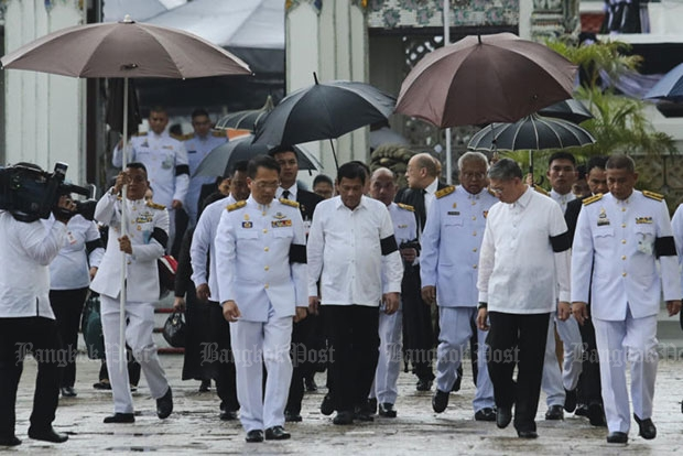 Philippine President Rodrigo Duterte arrives at the Grand Palace on Wednesday to pay respects to King Bhumibol Adujyadej at the Dusit Maha Prasat Throne Hall. (Photo by Patipat Janthong)