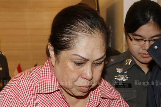 Kamonthat Thanathornkhositjira is taken to the Crime Suppress Division on Aug 27 this year, one day after she was arrested in Nakhon Sawan. (File photo by Apichit Jinakul)