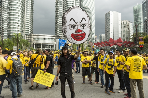 A protester holds up a large caricature of Prime Minister Najib Razak during the Bersih rally in Kuala Lumpur on Saturday. (Bloomberg Photo)