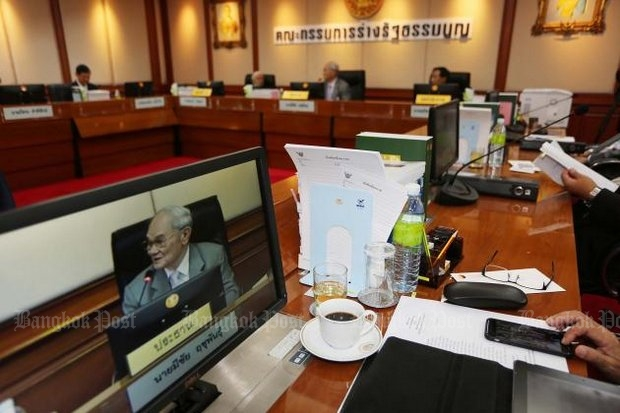 Meechai Ruchupan (on monitor screen and at head of table) and his Constitution Drafting Committee say they're almost finished with the organic laws, meaning they're almost finished with the new, improved constitution. (File photo)