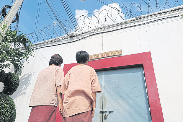 True love: A lesbian couple who were together before their arrest for drug offences are trying to maintain their relationship inside the prison. Photos: CHAIYOT YONGCHAROENCHAI