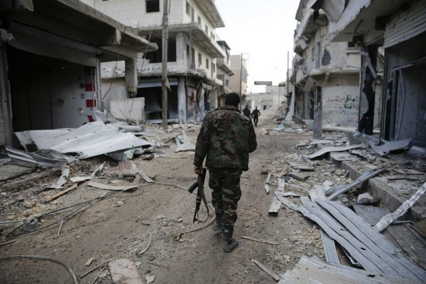 Syrian army soldiers patrol east Aleppo. The Trump administration will require a thoughtful, subtle and nuanced approach in order to eliminate the Islamic State from the entire world. (AP photo)