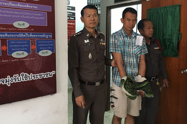 Thanapon Pareesen, 43, is held at Doi Lo district police station after his arrest on Thursday night for allegedly colluding in the murder of his wife, a senior nurse found burned to death at a fruit orchard on Monday. (Photo by Cheewin Sattha)