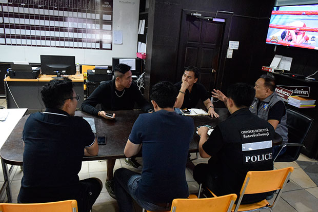 Investigators assemble at Pattaya police station on Sunday to try to discover the identity of a foreigner found dead off Koh Larn on Friday. (Photo by Treenai Chansrichol)