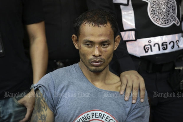 Driver Ekapot Yotsiri, after his arrest in Ekamai area following his rampage through traffic at the wheel of a truck, hitting 30 cars and 6 motorcycles. (Photo by Patipat Janthong)