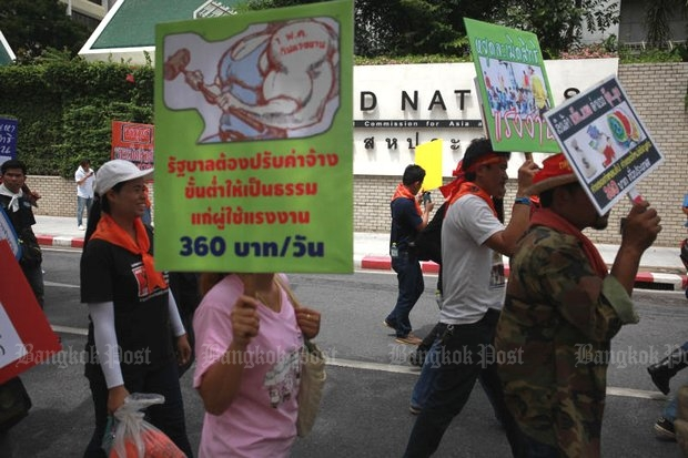 Workers marched at the United Nations (above), Army headquarters, the Democracy Monument and parliament for a minimum wage of at least 360 baht - to no avail. (File photo by Panupong Changchai)