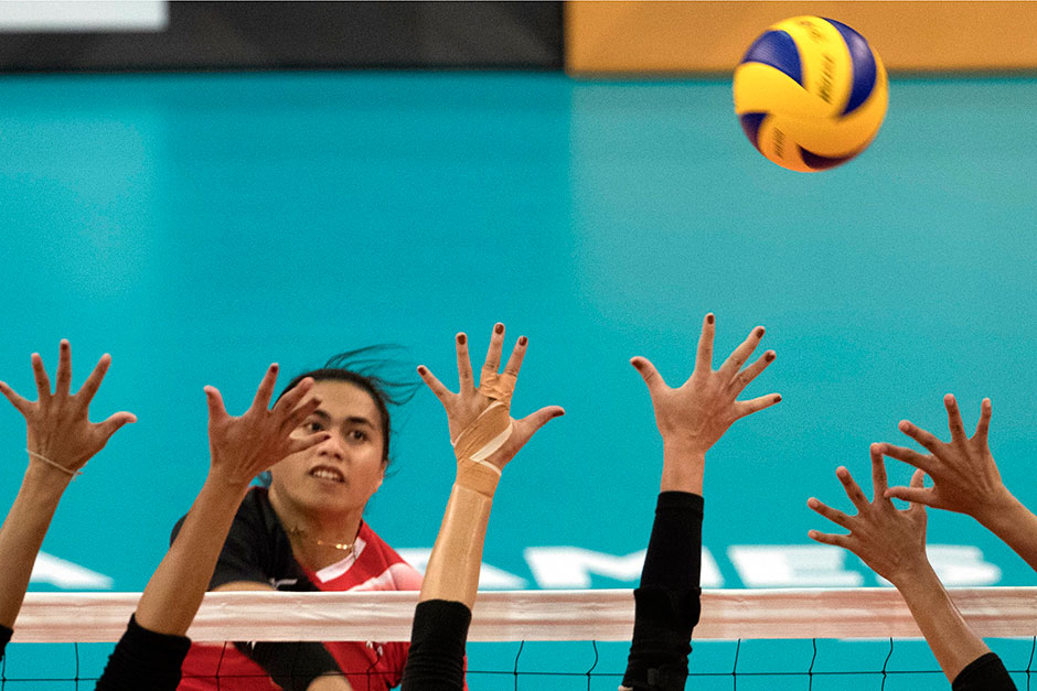 Hangestri Pertiwi Megawati of Indonesia is in action against Thailand in the SEA Games 2017 Women's Volleyball preliminary round event in Kuala Lumpur. The Thais won 3-0 (25-18, 25-16, 25-10). — EPA