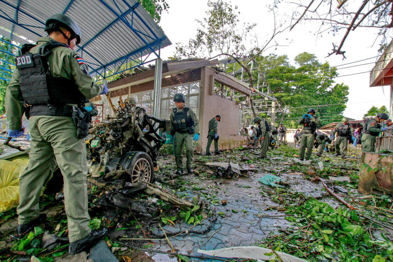 Military personnel inspect the site of a bomb attack in Yaring district, Pattani, on Nov 18, 2016. Army chief Gen Chalermchai Sittisat says he is confident violent unrest in the far South will be ease in the near future. — Reuters