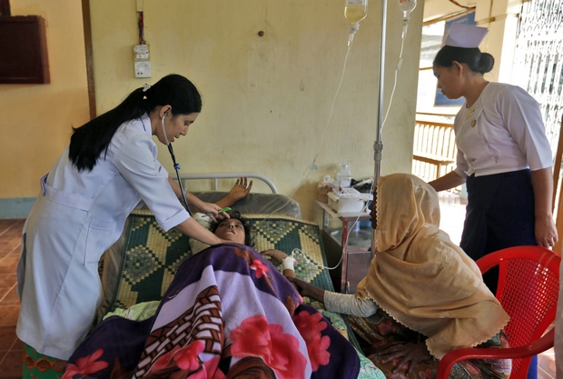 A Muslim woman receives medical treatment at a hospital in Buthee Taung town in Rakhine state, where an estimated 30,000 Rohingya have fled their homes in the face of an army crackdown against suspected insurgents. (EPA Photo)