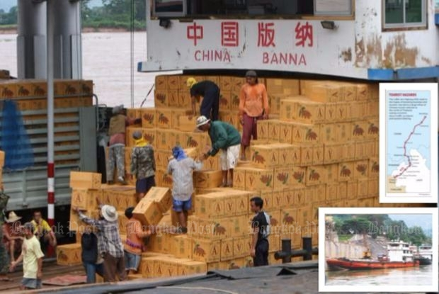 Goods being loaded on Chinese ships at Chiangsaen's port to travel upriver to Yunnan, China.