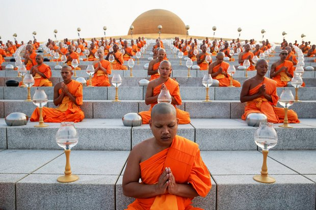 Monks pray on the steps of the Dhammakaya sect's main