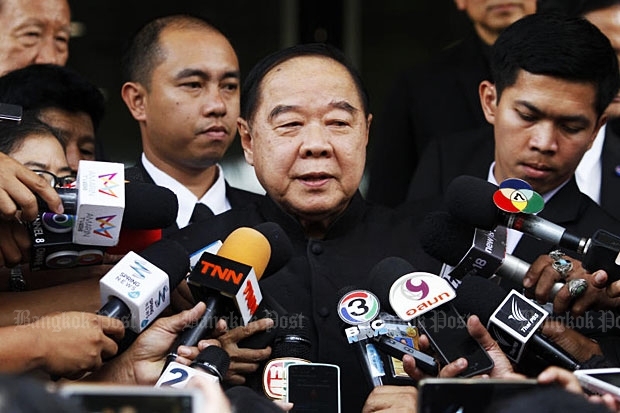 Deputy Prime Minister Prawit Wongsuwon takes questions from reporters at Government House on Thursday. (Photo by Thanarak Khunton)