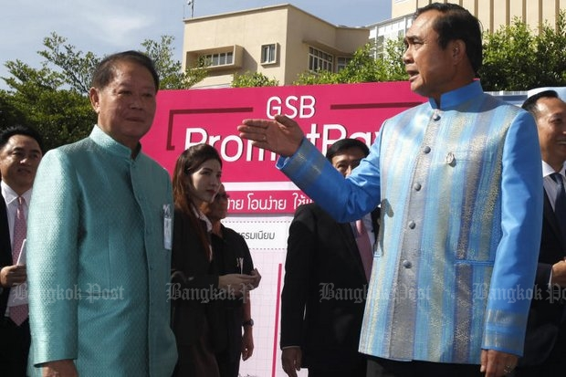 Launch of PromptPay I last August 9 at Government House by Prime Minister Prayut Chan-o-cha and Finance Minister Apisak Tantivorawong flopped when actual experts discovered security and communication flaws in the system. PromptPay II is to launch Friday. (File photo by Thanarak Khunton)