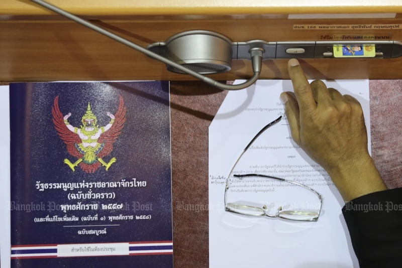 A copy of the charter is seen on a table of a National Legislative Assembly member during the NLA sitting to pass an amendment to the interim constitution on Jan 13, 2017. (Photo by Patipat Janthong)