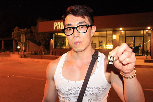 A Korean tourist known only as Chang Hyun shows a pendant after his necklace was snatched in the early hours of Saturday in Pattaya. (Photo by Chaiyot Pupattanapong)