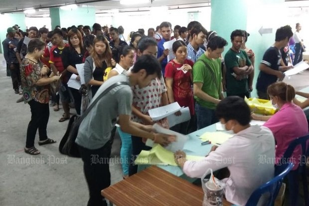 Migrant workers are required to register at both Labour Minister and (above) immigration offices least annually. The Labour Ministry says all migrants must have their nationalities verified by their home countries at their next registration date in 2017, or they will be deported. (Bangkok Post file photo)