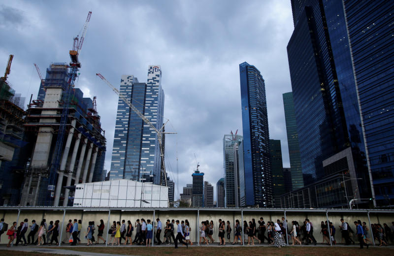 Office workers walk to the train station during evening rush hours in the financial district of Singapore. (Reuters photo)