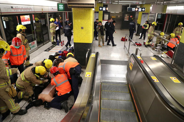 An injured person is under medical treatment inside a subway station in Hong Kong, China, on Friday. Apple Daily/via Reuters