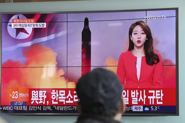 A man watches a TV news programme at the Seoul Train Station reporting about North Korea's missile launch with a file image of a North Korean missile. (AP Photo)