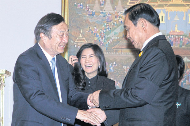 Prime Minister Prayut Chan-o-cha (right) greets Ren Zhengfei, founder and chief executive of Huawei Technologies, at Government House yesterday. THANARAK KHUNTON