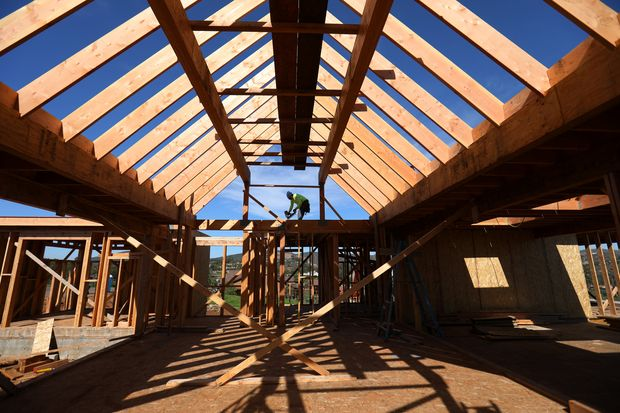 A construction worker builds a single family home in San Diego, California, on Feb 15, 2017. (Reuters photo)