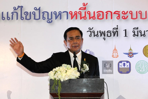 Prime Minister Prayut Chan-o-cha officially launches the government's efforts to end loan sharks at the Muang Thong Thani conventional complex in Nonthaburi province on Wednesday. (Photo by Wichan Charoenkiatpakul)