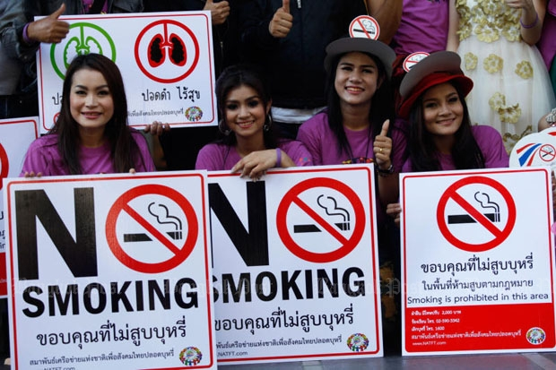 Anti-tobacco activists pose with their posters during a past campaign. The National Legislative Assembly on Friday passed amendments to the Tobacco Control Bill, aimed at reducing the number of people taking up the habit.(Photo by Jiraporn Kuhakan)
