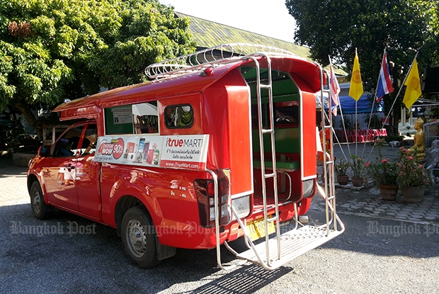 A red songtaew taxi is the general public vehicle for both locals and visitors of Chiang Mai.