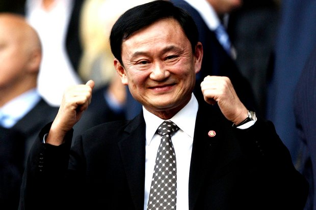 Some members of the government contend that ex-premier Thaksin owes 12 billion baht in taxes he avoided illegally when he sold Shin Corp to the Singaporean investors Temasek. (File photo)