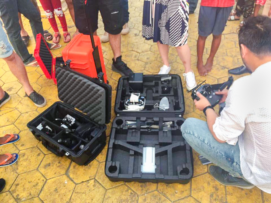 Officials inspect the offending drone. (Khmer Times photo)